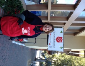Susan Clark ringing the bell for the Salvation Army in Carmel-by-the-Sea at the Post Office.