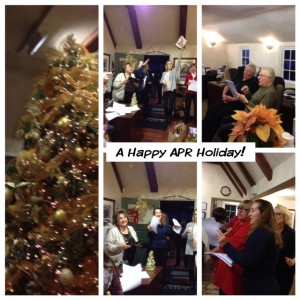 Alain Pinel agents celebrating singing holiday songs.