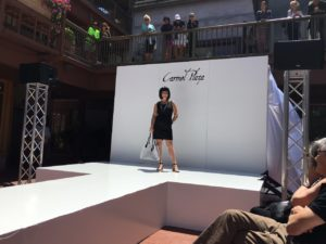Model on the runway in Carmel Plaza.