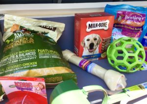 Doggie treats and playthings in the lid.
