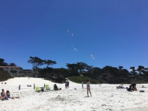 Carmel Beach - kite flying is a fun activity at the beach!